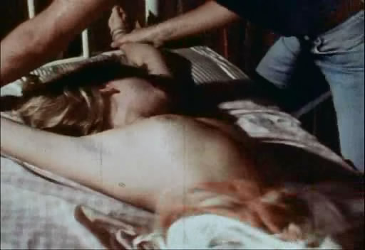 undress woman boobs in the movie The Howling