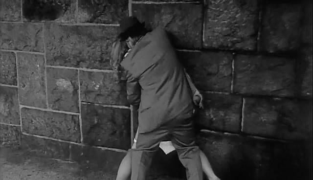 old man rape a woman against a wall